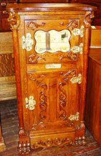 Rare highly carved oak parlor ice box