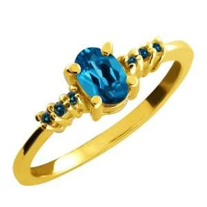0.59 Ct Oval London Blue Topaz and Blue Diamond 10k Yellow
